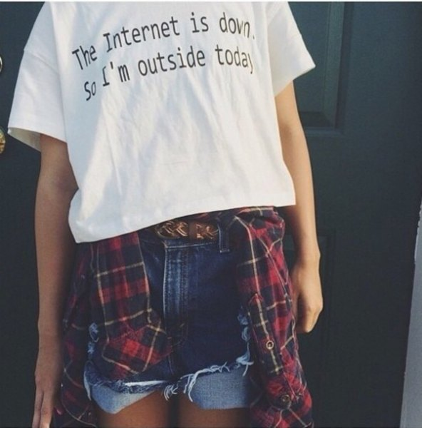 white printed t-shirt with blue denim shorts and red and black checked boyfriend shirt