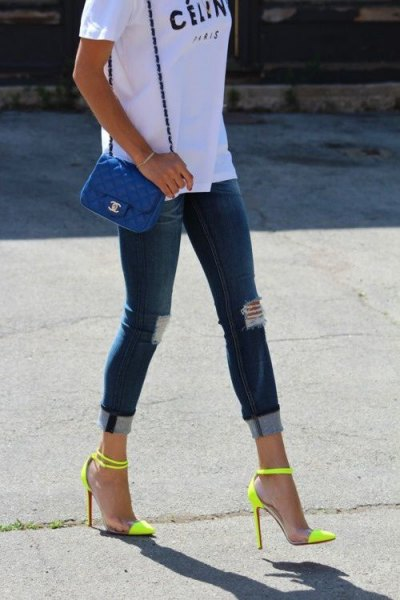 white printed T-shirt with dark blue skinny jeans and high heels