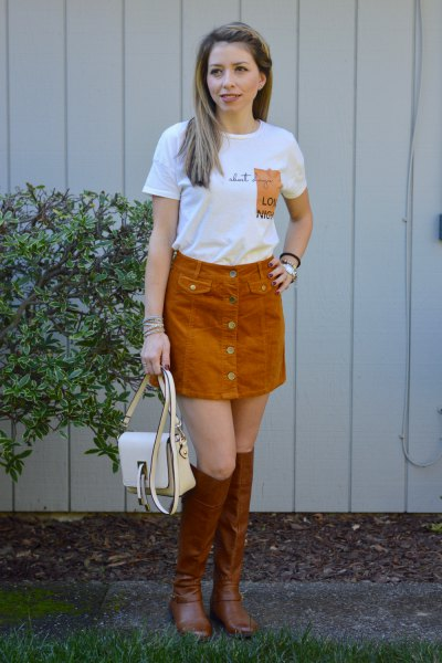white printed T-shirt with green corduroy skirt and brown boots