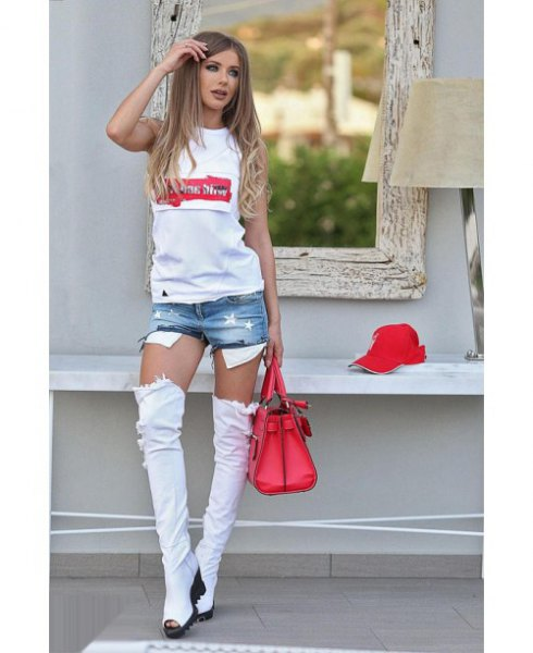 White printed T-shirt with mini denim shorts and light blue, knee-high, open toe boots