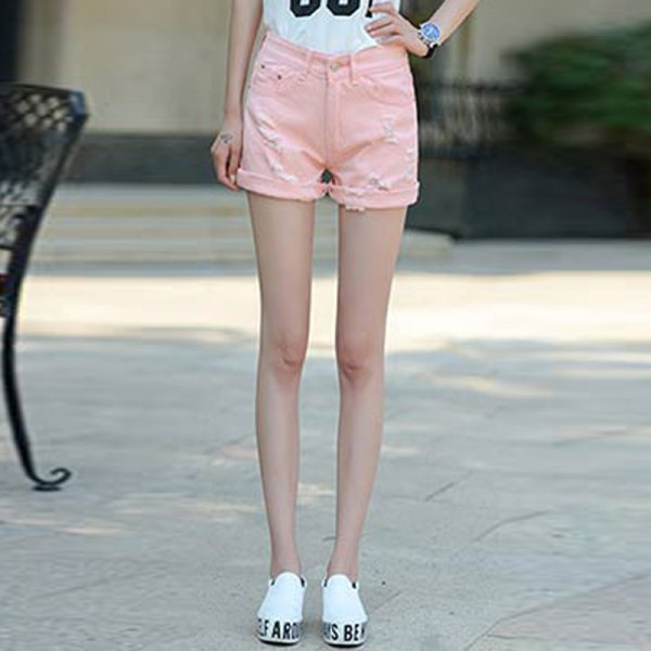 white printed t-shirt with light pink shorts and sneakers with cuffs