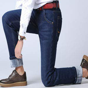 white printed blouse with dark blue, fleece-lined jeans with cuffs and oxford shoes