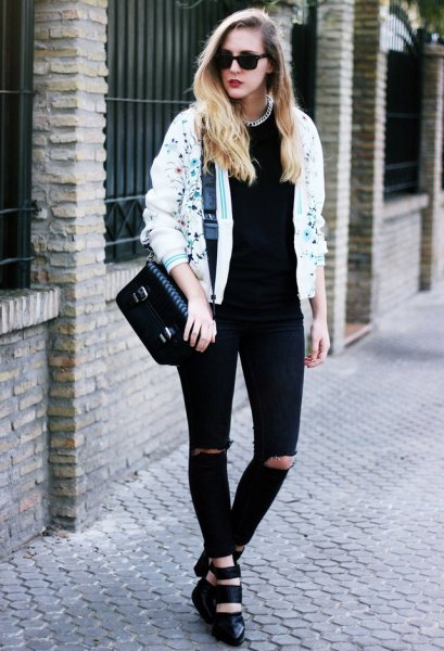 white printed bomber jacket and black jeans