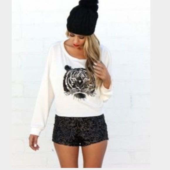 white printed sheater with relaxed fit, black shorts