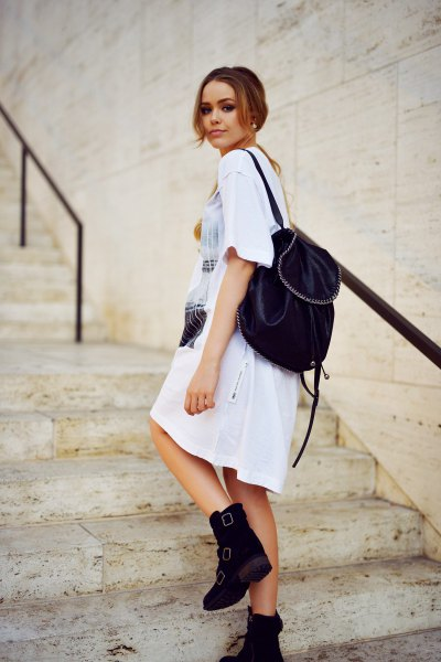 white printed t-shirt dress with ankle boots with velvet backpack purse