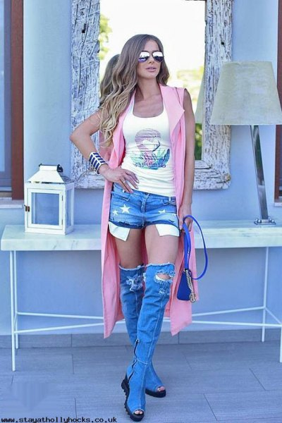 white printed tank top with gray longline vest and torn knee-high boots