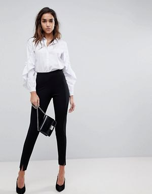 white shirt with puff sleeves and buttons with black chinos