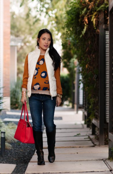 white puffer vest with a red printed pullover