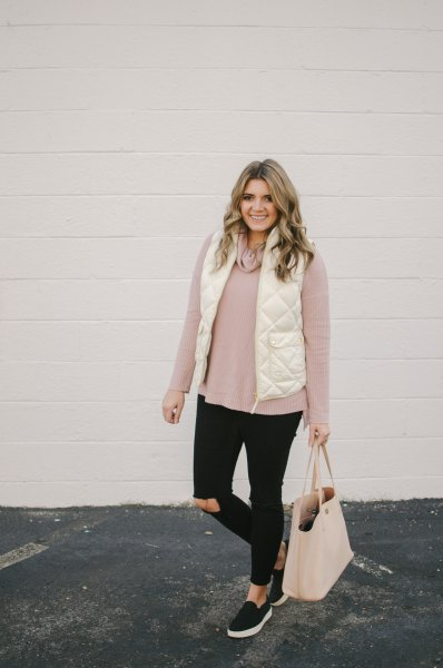 white quilted vest with light gray sweater and black jeans