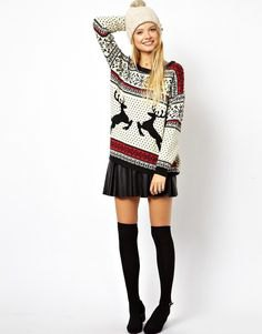 white, red and black printed sweater with mini pleated skirt