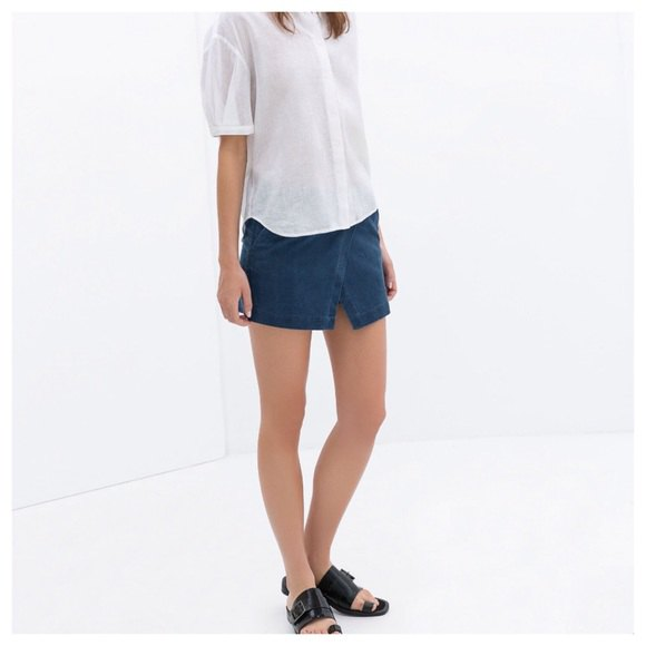 white relaxed fit button up shirt with dark blue skort