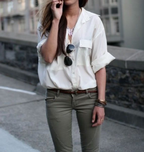 white shirt with a relaxed fit and gray skinny jeans