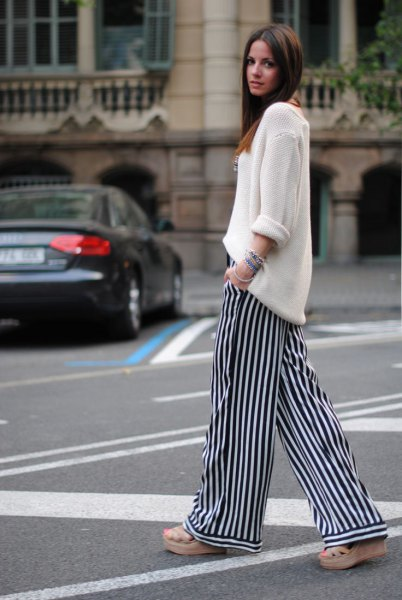 white knitted sweater with relaxed fit and striped pants