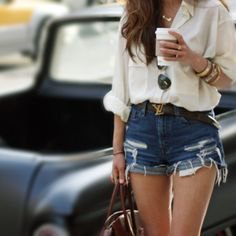 white, loose-fitting linen shirt with ripped blue denim shorts