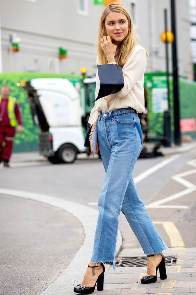 white sweater with relaxed fit and blue mom jeans