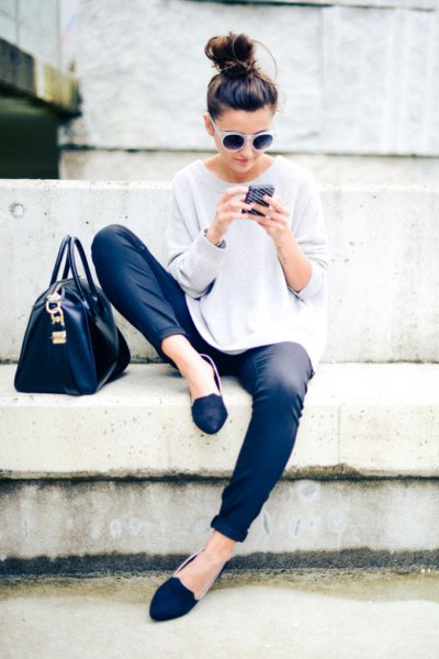 white sweater with relaxed fit, coated jeans and royal blue slippers