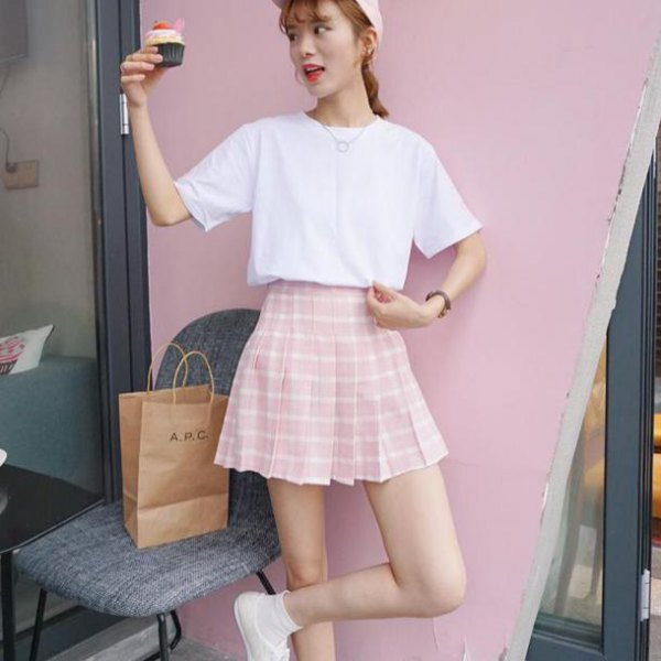 white t-shirt with relaxed fit and pink and white checked skater skirt