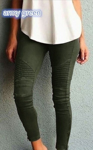 white, loose fitting tank top with dark green, pleated skinny jeans