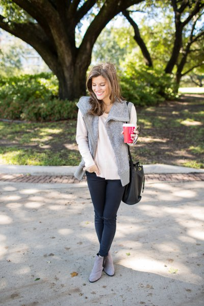 white, loose-fitting, thin sweater with gray faux fur vest