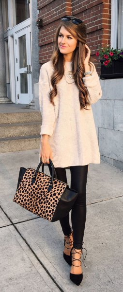 white ribbed large sweater with black leather gaiters