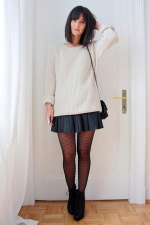 white, ribbed, coarsely knitted sweater with dark blue mini pleated skirt