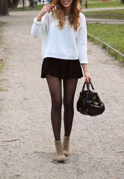 white ribbed comfortable sweater with black mini skirt