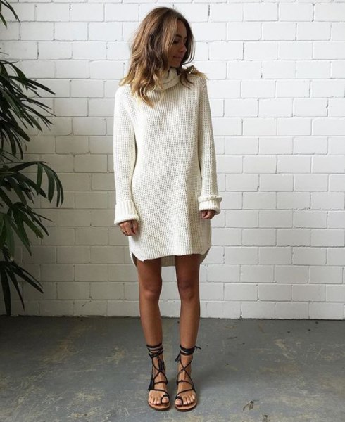 white, ribbed sweater dress with black, flat gladiator sandals