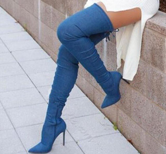 white, ribbed sweater dress with high-heeled jeans boots