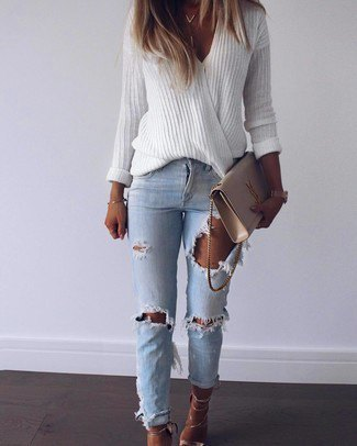 white oversized V-neck sweater and blue ribbed slim fit jeans