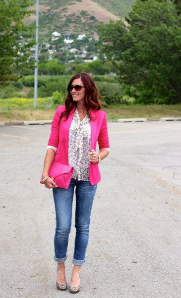 Blouse with a white bow pattern and neon pink blazer and jeans