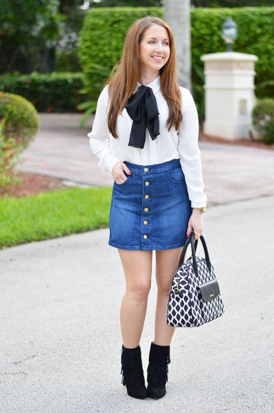 white ribbon bow shirt with button in front of denim skirt