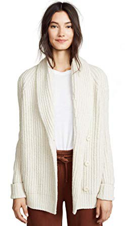 white, ripped cardigan with a round neckline