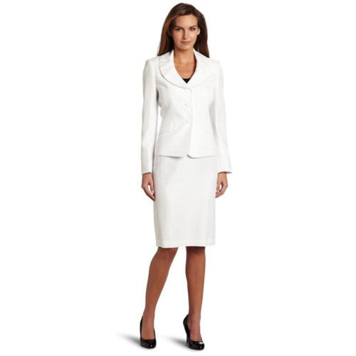 white blazer with a round collar, skirt and black, rounded leather heels