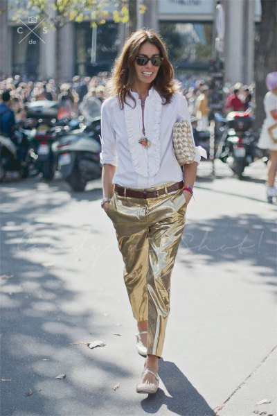 white blouse with frill neckline and gold metallic trousers