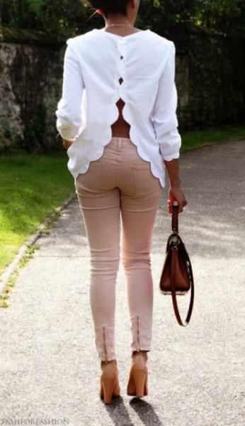 white scalloped neckline with pink skinny jeans