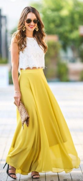 white top with scalloped hem and mustard-yellow, flowing maxi skirt