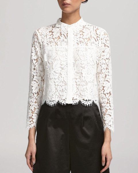 white lace shirt with scalloped hem, black trousers