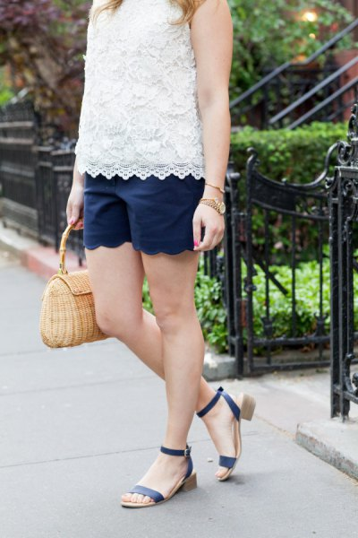 sleeveless lace top with white hem and matching dark blue shorts