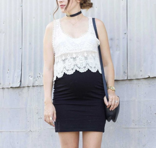 white lace top with scalloped hem and black, figure-hugging mini skirt