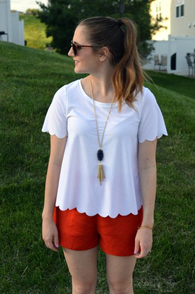 white scalloped t-shirt with red mini-shorts
