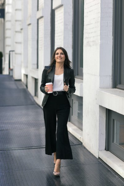 white blouse with scoop neckline and black, cropped pants with wide legs
