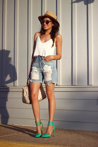 white crop top with scoop neckline, ripped denim shorts and straw hat