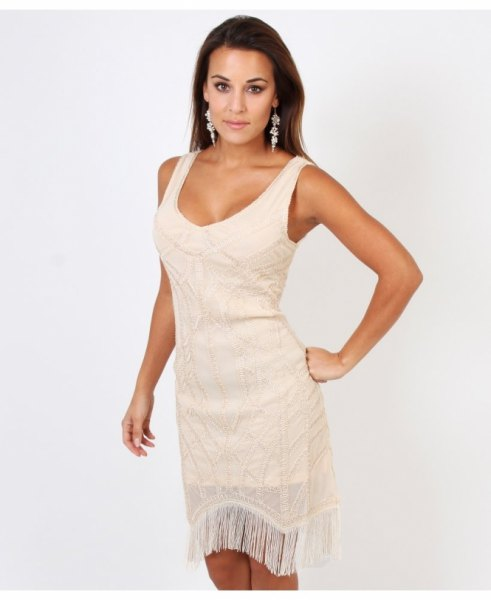 white mini dress with scoop neckline and fringes