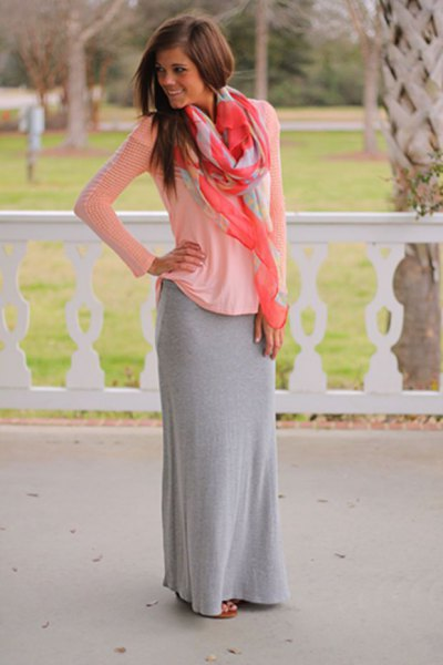 white long-sleeved top with a scoop neckline and floor-length skirt made of gray cotton