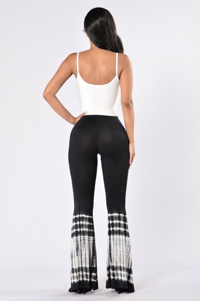 white tank top with scoop neckline and black yoga pants