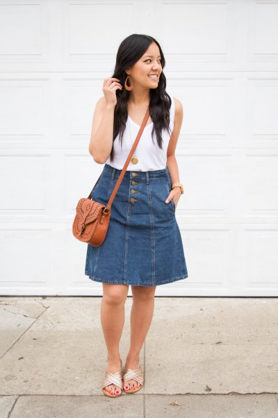 white tank top with scoop neckline and flared knee-length skirt made of blue denim