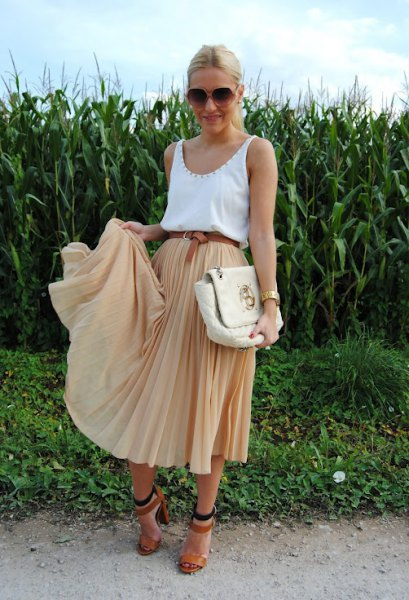white tank top with scoop neckline and red pleated midi skirt