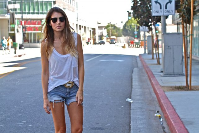 white tank top with scoop neckline and cut off jeans shorts