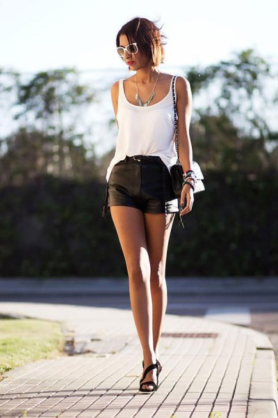 white tank top with scoop neckline and leather mini-shorts