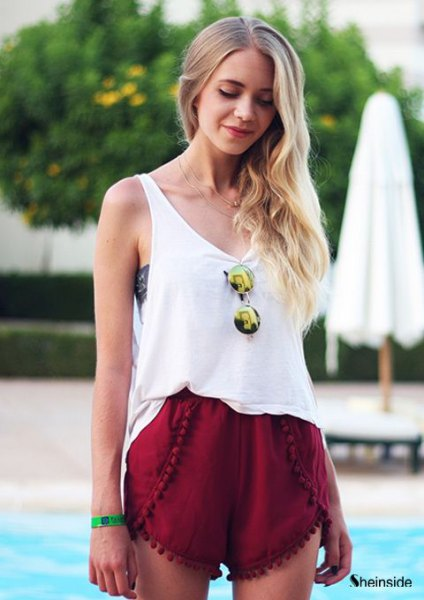 white tank top with scoop neckline and red mini-shorts